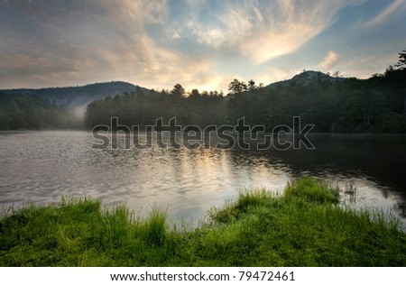 Sunrise over Mountain Lake, near Cashiers North Carolina - stock photo