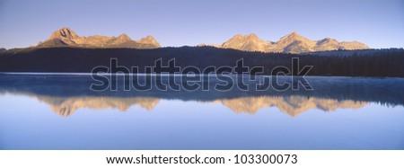 Sunrise over Redfish Lake and Sawtooth Mountains, Idaho - stock photo
