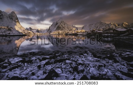 Sunrise over Reine, Lofoten islands, Norway in winter - stock photo