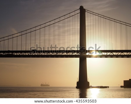 Sunrise over San Francisco Bay and the Bay Bridge with boats in the water and awesome clouds in the sky in California.  November 14, 2011. - stock photo