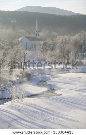 Sunrise over Stowe Community Church on a cold winter morning, Stowe, Vermont, USA - stock photo