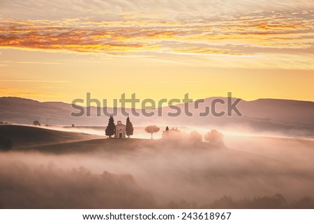 Sunrise over the chapel Vitaleta, beautiful landscape in the mist of Tuscany, Italy. - stock photo