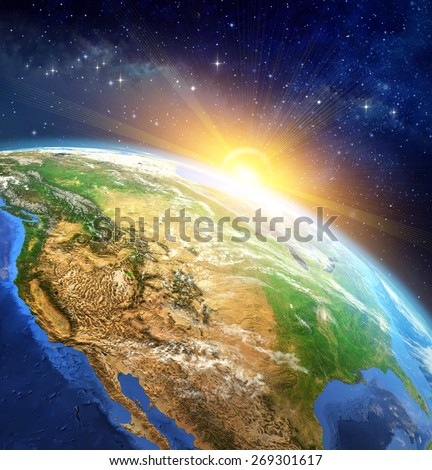 Sunrise over the Earth. Very high definition picture of planet earth in outer space with the rising sun. Elements of this image furnished by NASA - stock photo