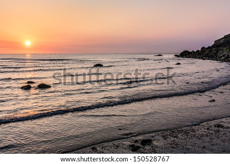 Sunrise over the Irish Sea at Bray County Wicklow Ireland - stock photo