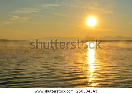 sunrise over the lake in West Thumb area in Yellowstone National Park, Wyoming - stock photo