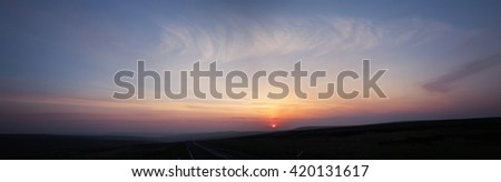 Sunrise over the road to Cragg Vale, West Yorkshire, England, UK - stock photo