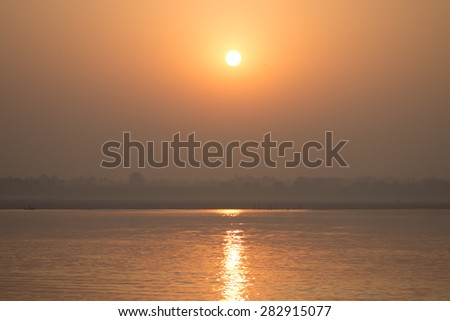 Sunrise over the sacred Indian river Ganga - stock photo