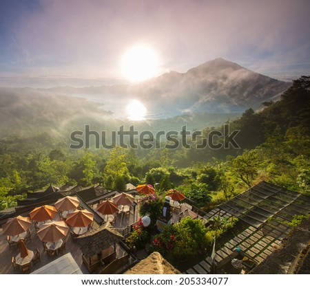 Sunrise over the valley with villages and lake situated in caldera of old giant volcano. Bali, Indonesia - stock photo
