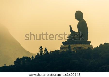 sunrise over Tian Tan Buddha on Lantau Island - stock photo