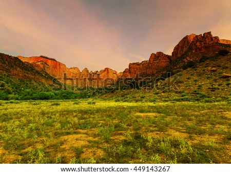 Sunrise scene over the Towers of the Virgin in Zion Canyon National Park, Utah. - stock photo