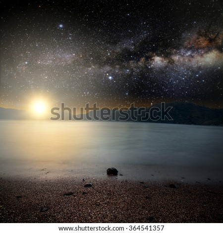 sunrise sea on the star and sky background . Elements of this image furnished by NASA - stock photo