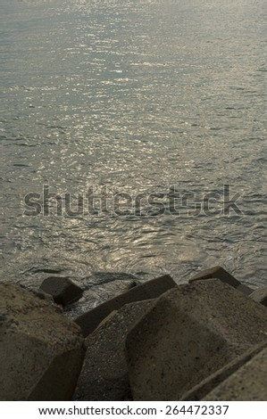 Sunrise Seascape with soft focus of rock as foreground (Soft focus, shallow DOF) - stock photo