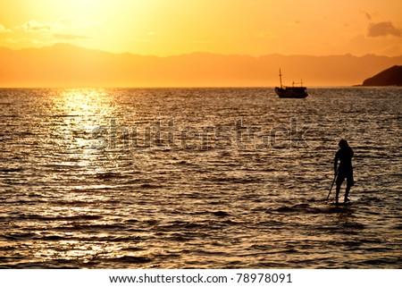 Sunrise Surfer - stock photo