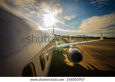 Sunrise view at the airport from the airplane. - stock photo