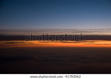 Sunrise view from the plane - stock photo