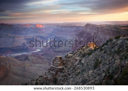 "Sunrise view of the Colorado River from the historic ""Desert View"" point at the South Rim of the Grand Canyon, AZ, USA - stock photo"