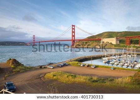 sunrise view of the Golden Gate Bridge, San Francisco (view from Presidio Yacht harbor) - stock photo