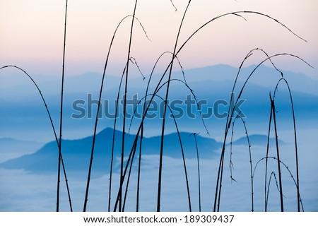 Sunrise view on misty blue cloudy Himalaya mountains - stock photo