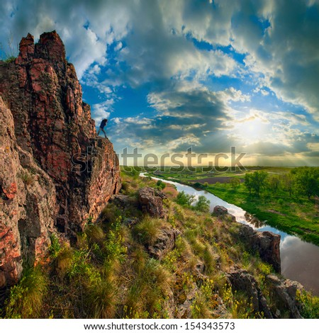 Sunrise with a beautiful sky in a high cliff valley - stock photo