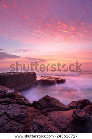Sunrise with beautiful skies and ocean flows at the North Avoca rock shelf. Central Coast, Australia.    A beautiful morning to behold - stock photo