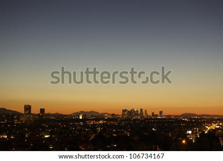 Sunrise with heat haze of Downtown Los Angeles skyline - stock photo