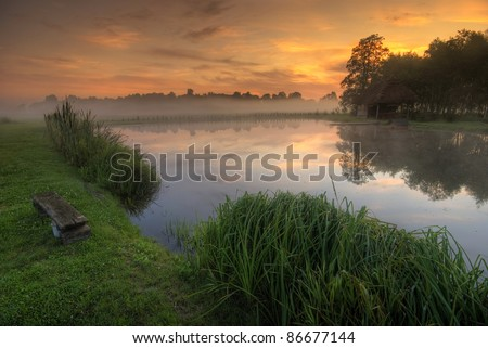 sunrise with the morning fog on the pond - stock photo