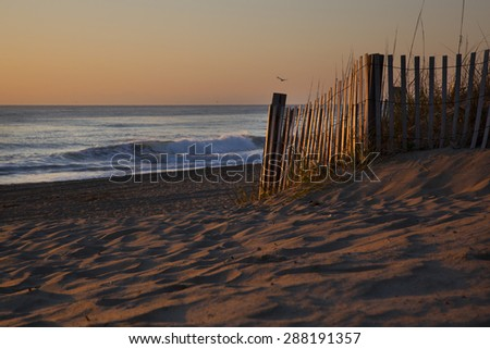 Sunrises are epic on the pristine beaches in the Outer Banks - stock photo