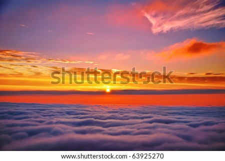 sunset above clouds - stock photo