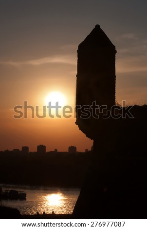 Sunset above the city with silhouettes of Belgrade's Kalemegdan fortress - stock photo