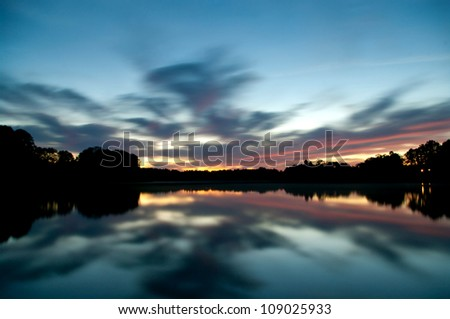 sunset above the lake with long exposure - stock photo