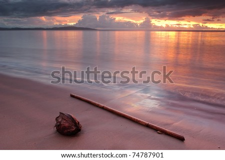 Sunset along Fiji coastline - stock photo