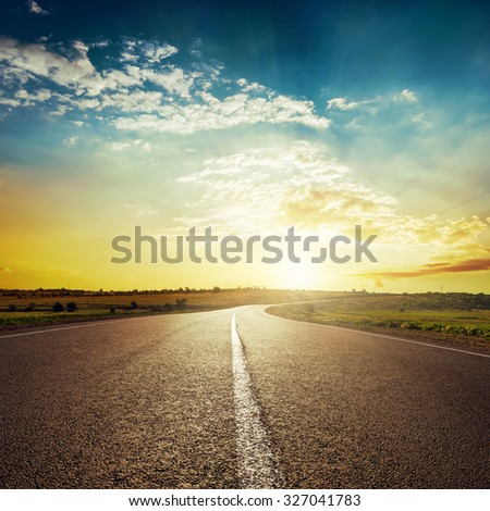sunset and asphalt road - stock photo
