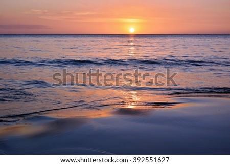 sunset and beach. Tanjung Aru sunset beach, Sabah Borneo - stock photo