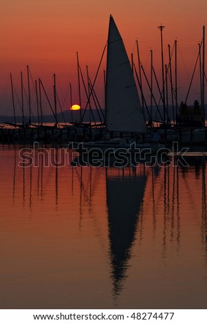 Sunset and boat with people 9. - stock photo