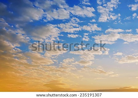 Sunset and clouds on blue sky - stock photo