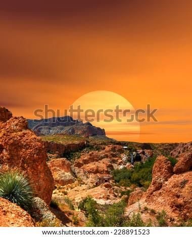 Sunset and gazebo in the Arizona desert hills - stock photo