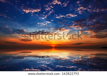 Sunset and reflection with beautiful sky  - stock photo