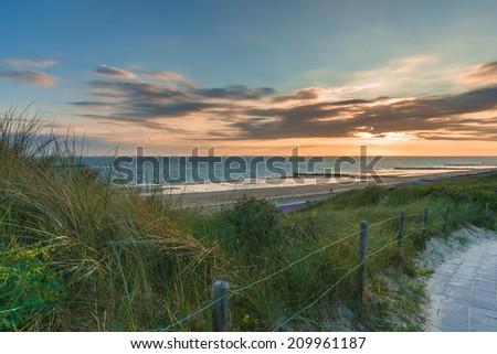 Sunset and Stormclouds  over the dunes of Zeeland in the Netherlands - stock photo