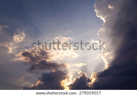 sunset and sunlight with dramatic cloud  - stock photo