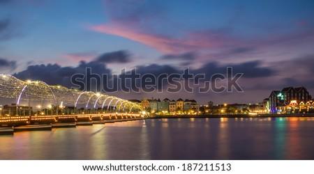 Sunset and the Floating bridge looking towrads Otrobanda and Punda Curacao - stock photo