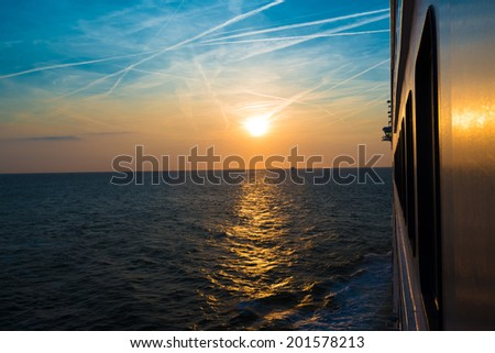 Sunset as seen from a luxury cruise liner on the North Sea - stock photo