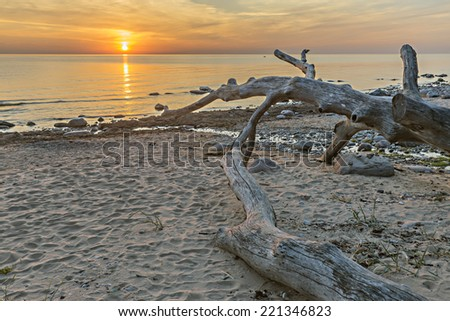 Sunset at a beach of the Baltic Sea - stock photo