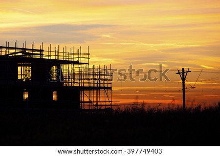 Sunset at a Dutch building house - stock photo