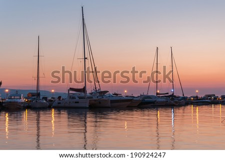 Sunset at a pier in Baska Voda in Croatia - stock photo