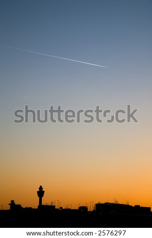 sunset at airport - stock photo