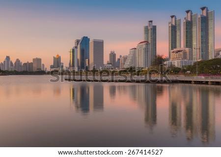 Sunset at Bangkok city downtown with reflection of skyline, Bangkok,Thailand - stock photo