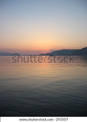 Sunset at fjord Storfjorden in Norway. - stock photo