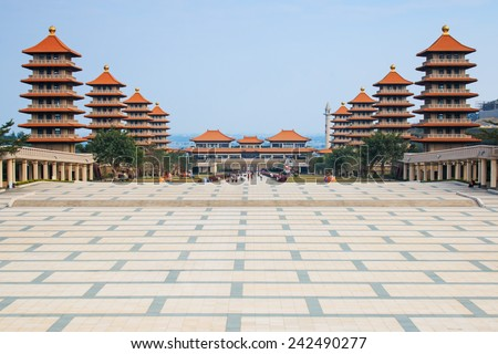Sunset at Fo Guang Shan buddist temple of Kaohsiung, Taiwan with many tourists walking by. - stock photo