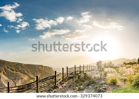 Sunset at Jabal Akhdar in Al Hajar Mountains, Oman. It extends about 300 km northwest to southeast, between 50-100 km inland from the Gulf of Oman coast. - stock photo