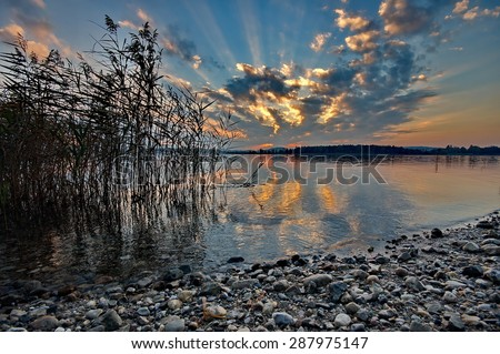 Sunset at lake Chiemsee in Germany - stock photo